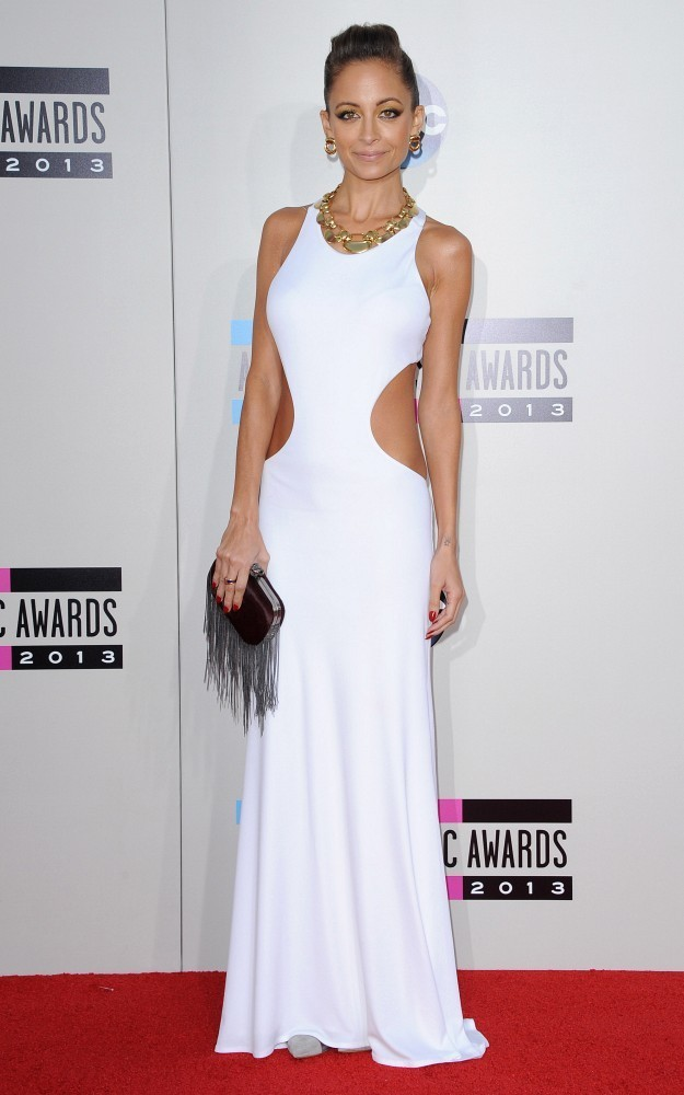 NICOLE RICHIE in Emilio Pucci white cut-out gown.