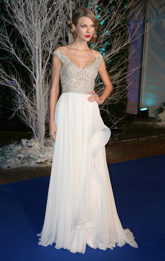 TAYLOR SWIFT in Reem Acra gown with an embellished bodice and ruffled chiffon skirt