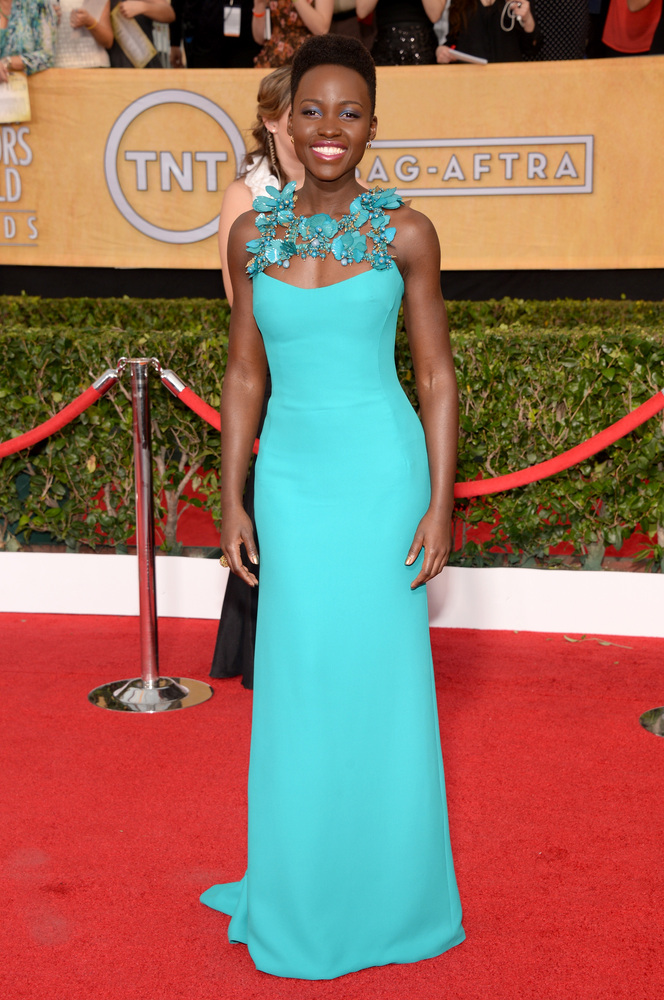 LUPITA NYONG'O wearing a Gucci gown with Fred Leighton jewelry
